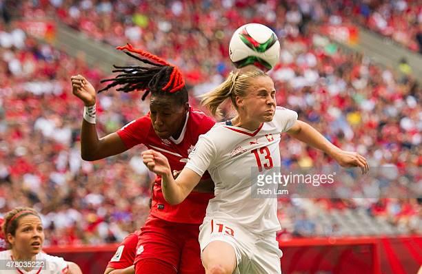 AnaMaria Crnogorcevic of Switzerland wins a header over Kadeisha Buchanan of Canada during the FIFA Women's World Cup Canada 2015 Round of 16 match...
