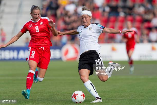 AnaMaria Crnogoreevic of Switzerland and Lisa Makas of Austria controls the ball during the Group C match between Austria and Switzerland during the...