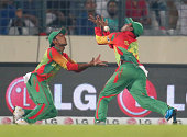 Anamul Haque and Sohag Gazi of Bangladesh drop a catch in the outfield during the ICC World Twenty20 Bangladesh 2014 match between Bangladesh and...