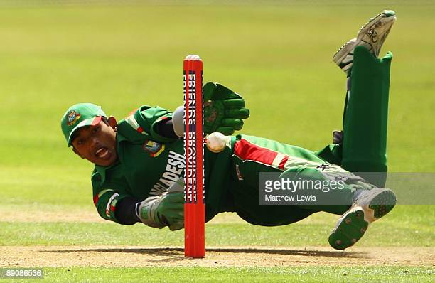 Anamul Haque Bijoy of Bangladesh looks to stump Jake Manuel of England during the Friends Provident One Day International match between England U19...