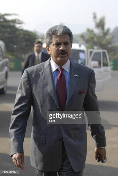 Anand Mahindra Vice president of Mahindra Mahindra Auto walks towards the opening ceremony of New Mahindra Xylo car at the company's plant in Nashik