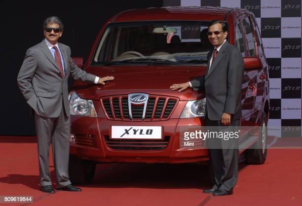 Anand Mahindra Vice president of Mahindra Mahindra Auto with Pawan Goenka automotive sector of the company during the launch of the New Mahindra Xylo...
