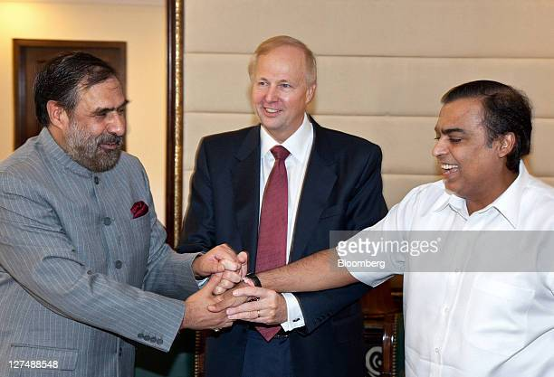 Anand Sharma India's minister of Commerce and Industry left shakes hands with Robert Dudley chief executive officer of BP Plc center and Mukesh...
