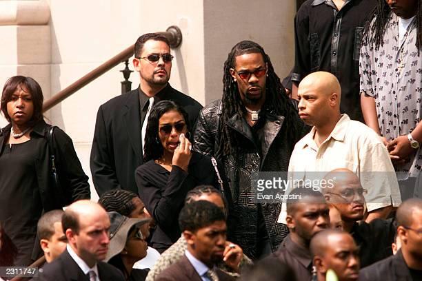 Ananda Lewis and Busta Rhymes leaving R B singer Aaliyah's memorial service at St Ignatius Loyola Roman Catholic Church in New York City 8/31/2001...