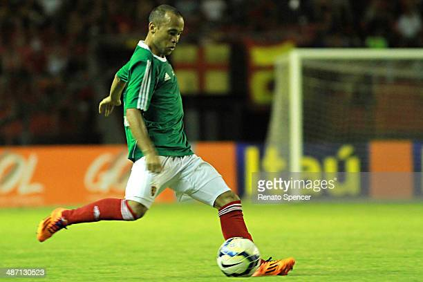 Ananias of Sport Recife shoots at goal during the Brasileirao Series A 2014 match between Sport Recife and Chapecoense at Ilha do Retiro Stadium on...