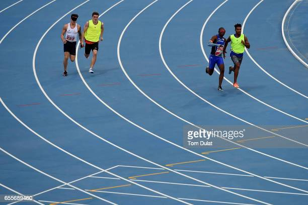 Ananias Shikongo of Namibia and Dan Powell of Great Britain compete in 200m Men race during the 9th Fazza International IPC Athletics Grand Prix...