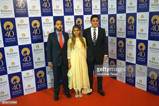 Anant Ambani Isha Ambani Aakash Ambani children of RIL Chairman Mukesh Ambani pose for a photograph before the 40th AGM of Reliance Industries...