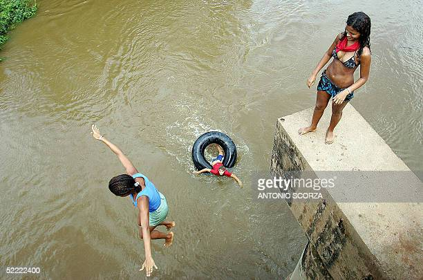 Anapu's resident Rita da Silva looks at a friend jumping into the Anapu river 19 February in the Amazon rain forest 30 Km from Anapu northern Brazil...