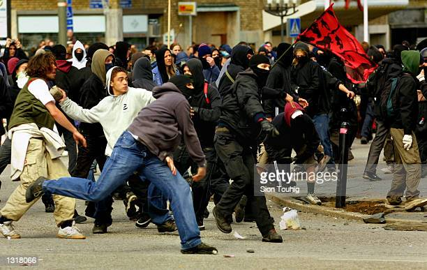 Anarchist protesters throwing stones at the riot police as fighting breaks out during a demonstration against the EU Summit June 15 2001 in...