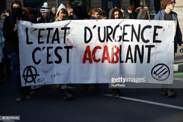 Anarchists hold a banner reading 'State of emergency it's oppressive' More than 4000 protesters took to the streets of Toulouse against the new...