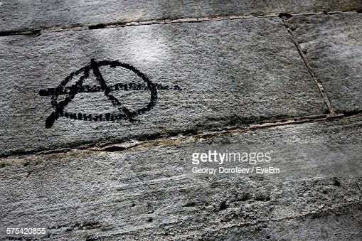 Anarchy Sign On Stone