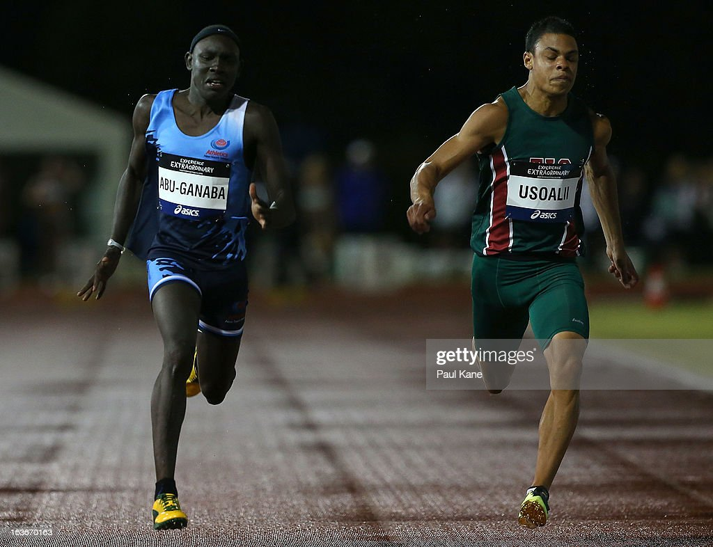 Anas Abu-Ganaba of New South Wales and Jesse Usoalii of Tasmania compete in the men's 100 u18 100 mtr final during day three of the Australian Junior Championships at the WA Athletics Stadium on March 14, 2013 in Perth, Australia.