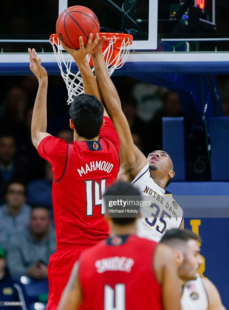 Anas Mahmoud #14 of the Louisville Cardinals shoots the ball as Bonzie Colson #35 of the Notre Dame Fighting Irish defends at Purcell Pavilion on January 4, 2017 in South Bend, Indiana.