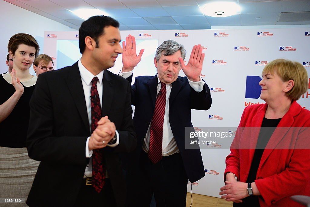 Anas Sarwar MP, Former British Prime Minister <a gi-track='captionPersonalityLinkClicked' href=/galleries/search?phrase=Gordon+Brown&family=editorial&specificpeople=158992 ng-click='$event.stopPropagation()'>Gordon Brown</a> and Leader of the Scottish Labour party Johann Lamont attend the Scottish Labour launch to keep Scotland as part of the UK on May 13, 2013 in Glasgow, Scotland. The party launched its 'United with Labour' campaign today which it says offers the people of Scotland a ''different view ''on the country's future.