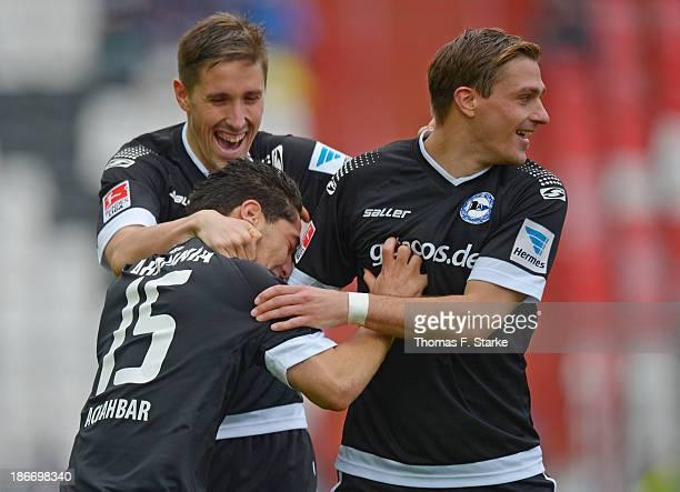 Anass Achahbar Jan Fiesser and Tom Schuetz of Bielefeld celebrate during the Second Bundesliga match between Karslruher SC and Arminia Bielefeld at...