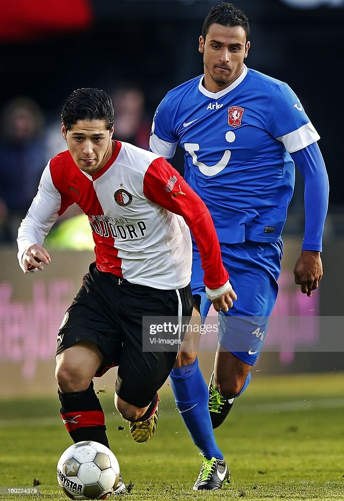 Anass Achahbar of Feyenoord (L), Nacer Chadli of FC Twente (R) during the Dutch Eredivise match between Feyenoord and FC Twente at stadium De Kuip on January 27, 2013 in Rotterdam, The Netherlands.