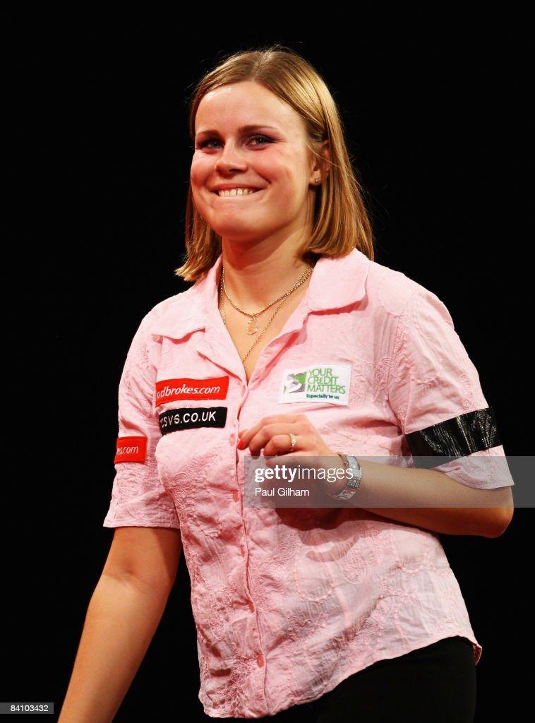 Anastasia Dobromyslova smiles during the first round match between Remco van Eijden of Netherlands and Anastasia Dobromyslova of Russia during the...