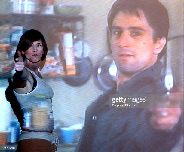 Anastasia Fite the originator of 'movieoke' acts out a scene of Taxidriver with Robert De Niro at the Den of Cin bar January 14 2003 in New York City...
