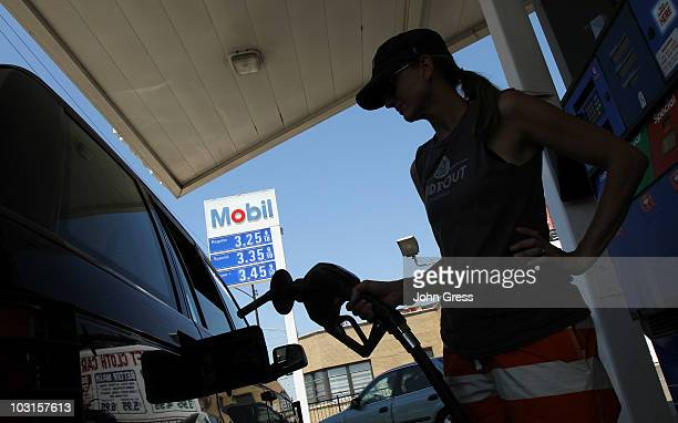Anastasia Hinchsliff fuels her SUV at an Exxon Mobile gas station July 29 2010 in Chicago Illinois Exxon Mobile's quarterly profits were released...