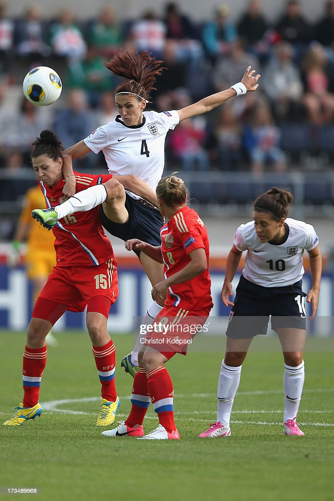 Anastasia Kostyukova (L) and Valentina Savchenkova of Russia (3rd L) challenge Jill Scott (2nd L) of England during the UEFA Women's EURO 2013 Group C match between England and Russia at Linkoping Arena on July 15, 2013 in Linkoping, Sweden.