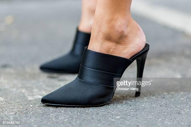 Anastasia Liuska wearing black Mango mules during Milan Fashion Week Spring/Summer 2017 on September 25 2016 in Milan Italy