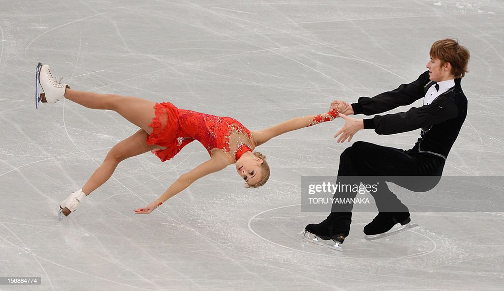 Anastasia Martiusheva (L) and Alexei Rogonov of Russia perform during the pairs' short program in the NHK Trophy, the last leg of the six-stage ISU figure skating Grand Prix series, in Rifu, northern Japan, on November 24, 2012. AFP PHOTO / Toru YAMANAKA