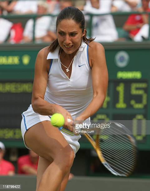Anastasia Myskina of Russia during her 16 63 36 defeat by France's Amelie Mauresmo in the quarterfinal of the Wimbledon Championships at the All...
