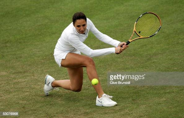 Anastasia Myskina of Russia hits a backhand during her quarter final match against Roberta Vinci of Italy during the Hastings Direct International...