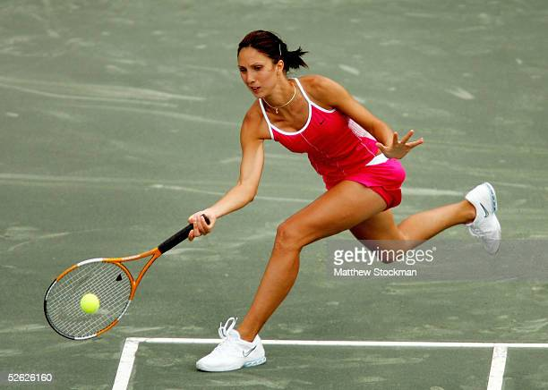 Anastasia Myskina of Russia returns a shot to Nicole Vaidisova of the Czech Republic during the Family Circle Cup at Family Circle Magazine Stadium...