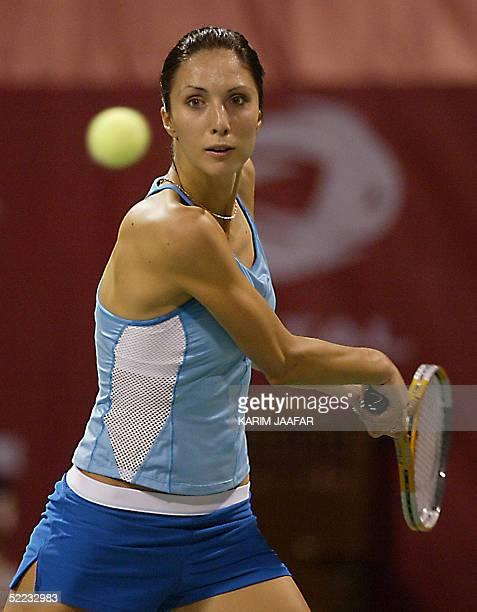 Anastasia Myskina of Russia returns the ball to Conchita Martinez of Spain during their WTA Qatar Open tennis match in Doha 23 February 2005 Veteran...