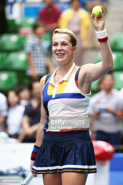 Anastasia Pavlyuchenkova of Russia celebrate defeating Qiang Wang of China during day three of the Toray Pan Pacific Open Tennis At Ariake Coliseum...
