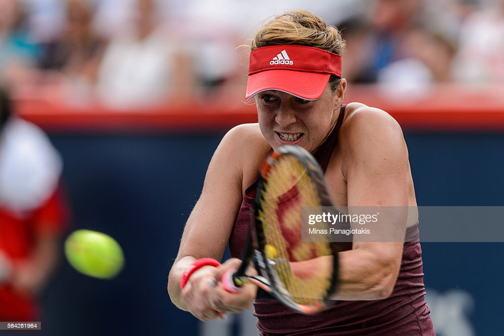 Anastasia Pavlyuchenkova of Russia hits a return against Agnieszka Radwanska of Poland during day four of the Rogers Cup at Uniprix Stadium on July...