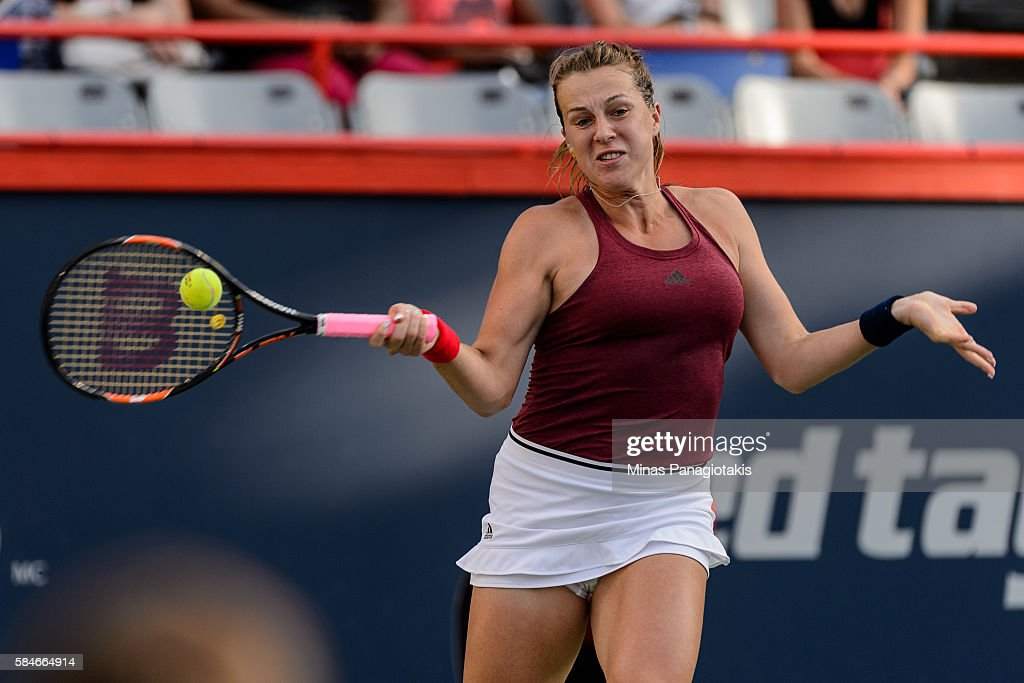 Anastasia Pavlyuchenkova of Russia hits a return against Madison Keys of the United States during day five of the Rogers Cup at Uniprix Stadium on...