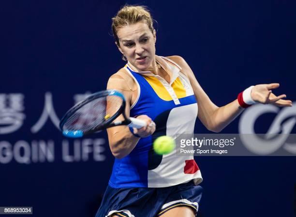 Anastasia Pavlyuchenkova of Russia hits a return during the singles Round Robin match of the WTA Elite Trophy Zhuhai 2017 against Ashleigh Barty of...