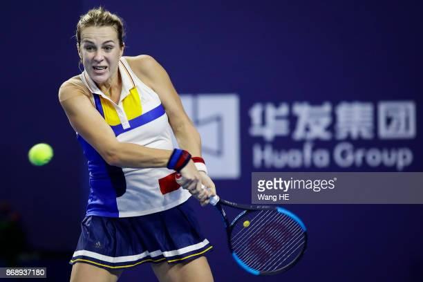Anastasia Pavlyuchenkova of Russia hits a return in her match against Ashleigh Barty of Australia during the WTA Elite Trophy Zhuhai 2017 at Hengqin...