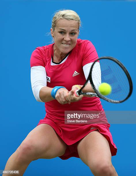 Anastasia Pavlyuchenkova of Russia plays a backhand against Agnieszka Radwanska of Poland during their Women's Singles first round match on day three...