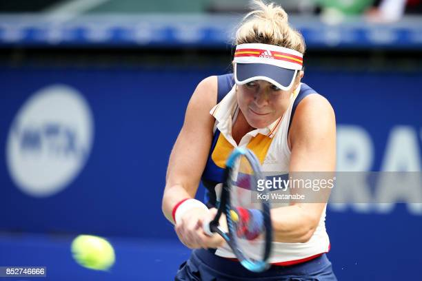 Anastasia Pavlyuchenkova of Russia plays a backhand against Caroline Wozniacki of Denmark during the women's singles final match during day seven of...