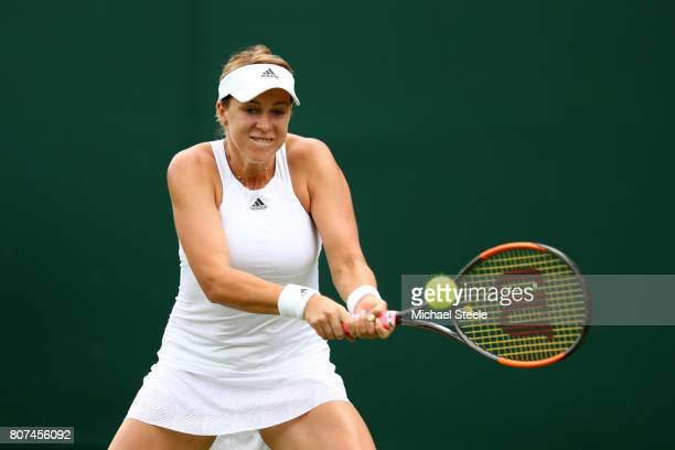 Anastasia Pavlyuchenkova of Russia plays a backhand during the Ladies Singles first round match against Arina Rodionova of Australia on day two of...