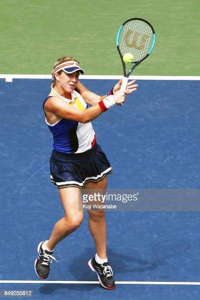 Anastasia Pavlyuchenkova of Russia plays a backhand in her match against Catherine Bellis of the United States during day two of the Toray Pan...