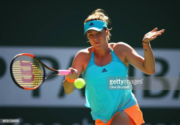 Anastasia Pavlyuchenkova of Russia plays a forehand against Dominika Cibulkova of Slovakia in their fourth round match during day nine of the BNP...
