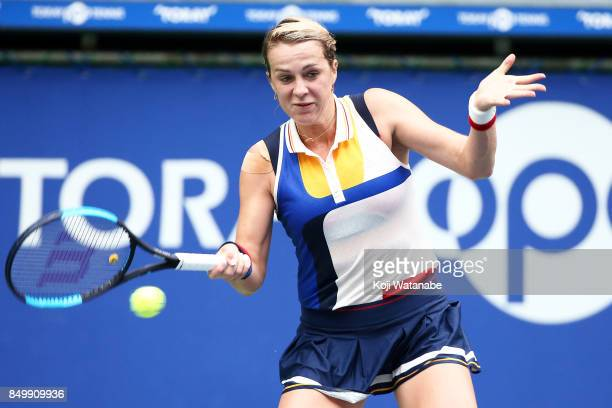 Anastasia Pavlyuchenkova of Russia plays a forehand against Qiang Wang of China during day three of the Toray Pan Pacific Open Tennis At Ariake...