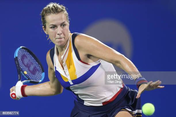 Anastasia Pavlyuchenkova of Russia plays a forehand during the match against Aliz Cornet of France on Day 2 of 2017 Dongfeng Motor Wuhan Open at...