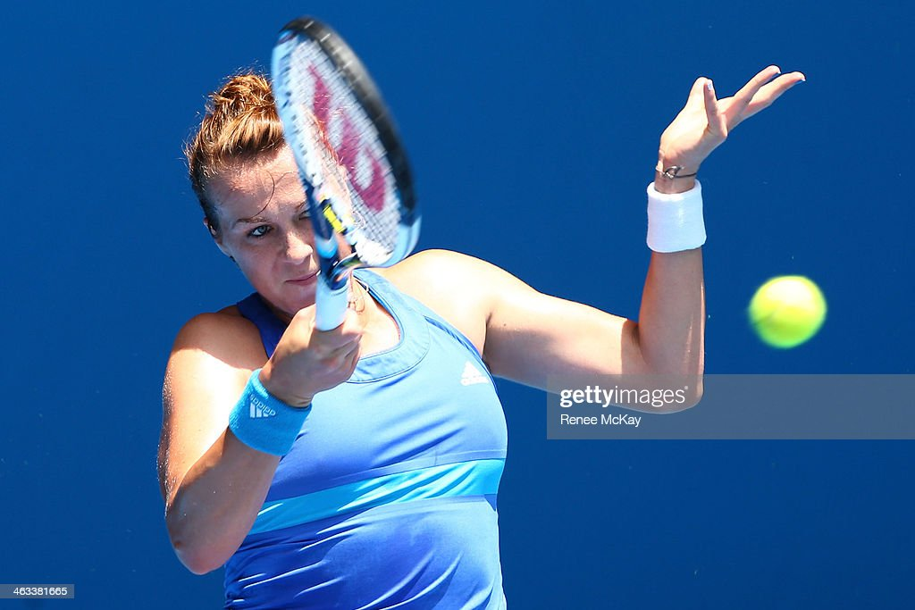 Anastasia Pavlyuchenkova of Russia plays a forehand in her third round match against Agnieszka Radwanska of Poland during day six of the 2014 Australian Open at Melbourne Park on January 18, 2014 in Melbourne, Australia.