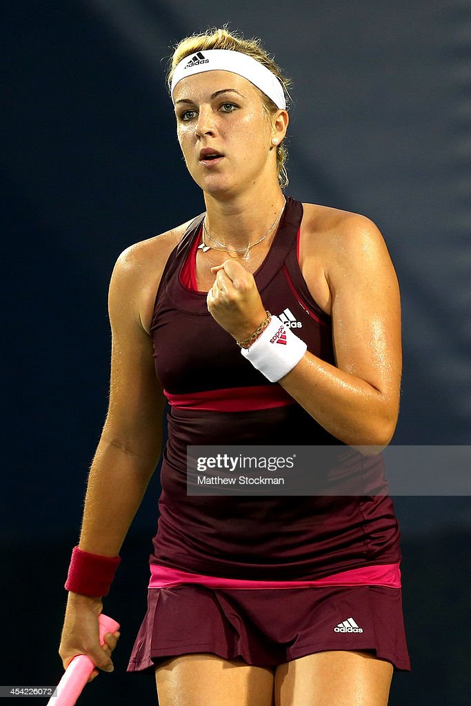 Anastasia Pavlyuchenkova of Russia reacts against Teliana Pereira of Brazil during her women's singles first round match on Day Two of the 2014 US...