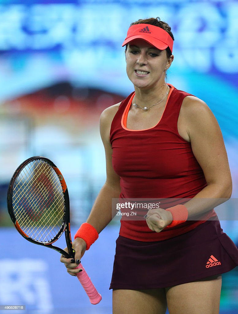 <a gi-track='captionPersonalityLinkClicked' href=/galleries/search?phrase=Anastasia+Pavlyuchenkova&family=editorial&specificpeople=579686 ng-click='$event.stopPropagation()'>Anastasia Pavlyuchenkova</a> of Russia reacts during the match against Simona Halep of Romania on Day 3 of 2015 Dongfeng Motor Wuhan Open at Optics Valley International Tennis Center on September 29, 2015 in Wuhan, China.