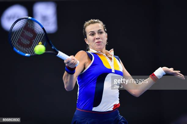 Anastasia Pavlyuchenkova of Russia returns a shot against Caroline Wozniacki of Denmark during the women's singles first round on day three of 2017...