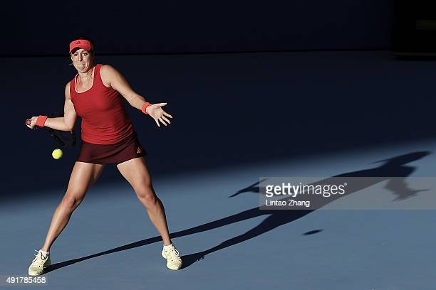 Anastasia Pavlyuchenkova of Russia returns a shot against Flavia Penneta of Italy during the Women's singles Second round match on day six of the...