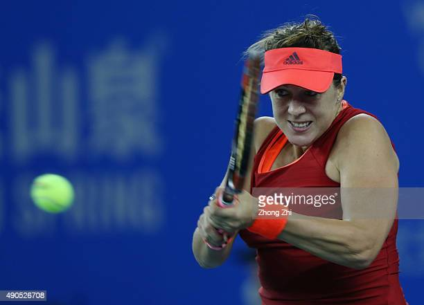 Anastasia Pavlyuchenkova of Russia returns a shot during the match against Simona Halep of Romania on Day 3 of 2015 Dongfeng Motor Wuhan Open at...