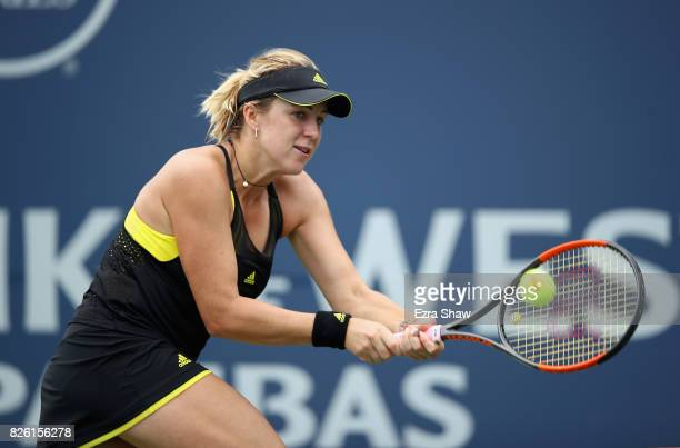Anastasia Pavlyuchenkova of Russia returns a shot to Alison Riske of the United States during Day 4 of the Bank of the West Classic at Stanford...