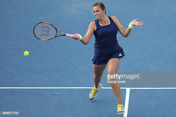 Anastasia Pavlyuchenkova of Russia returns a shot to Sloane Stephens of the United States in the women's singles final during the Citi Open at Rock...